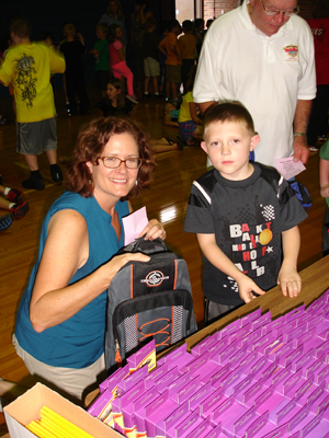 Laurie Evans and a Letcher County student choose a box of crayons.