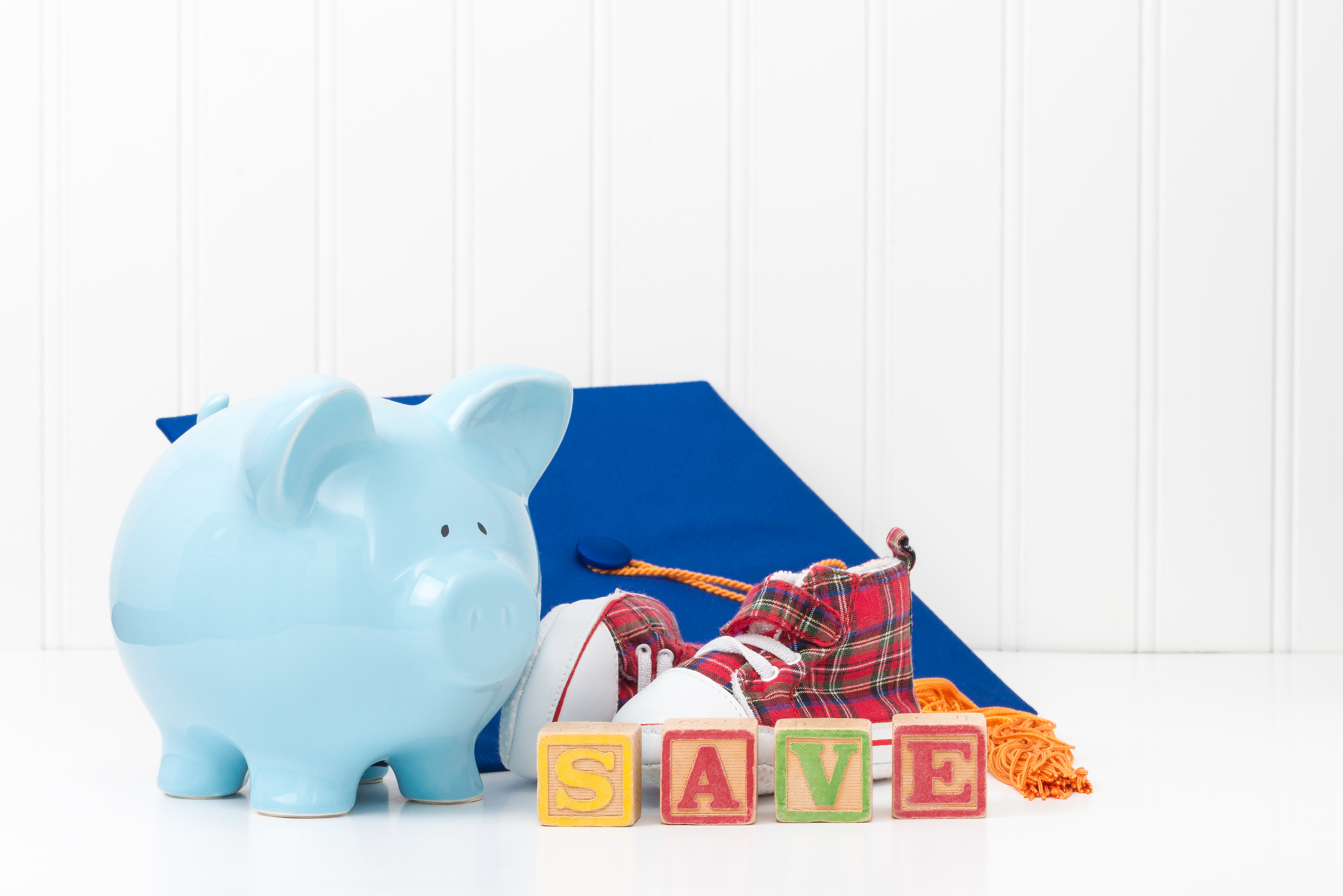 Piggy bank and infant shoes.  Conveys the concept that it is never too early to start saving.